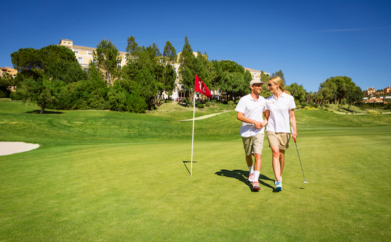 Happy couple exiting the18th hole at Montecastillo Golf, Spain