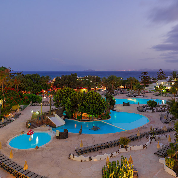 Night time view of the pool and sea from the H10 Lanzarote Princess